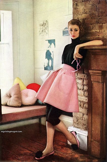 Love the sweet, chic look of this fun daytime look from 1951. #1950s #vintage #pink #fashion #fifties #clothing #pink #glasses #skirt #apron #black #pants #model