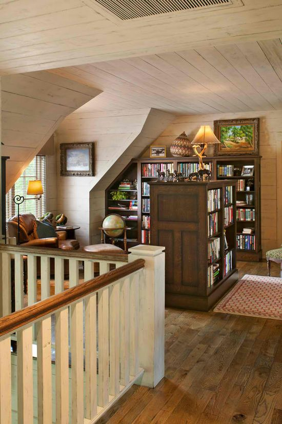 I will never have a house so big it warrants something like this, but a girl can dream. Home library - great use of space for an awkward loft / stair landing
