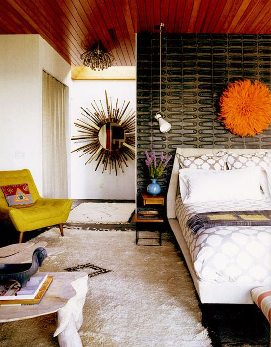 Eclectic boho bedroom and fluffy rug. Love the bedding