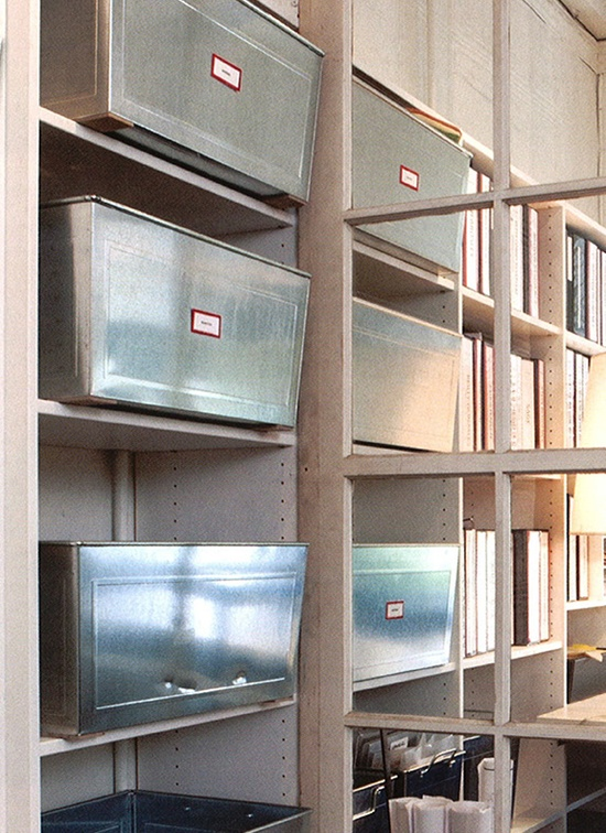 Metal bin storage at office of DeCesare Design