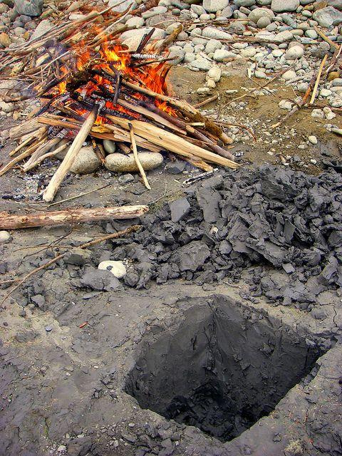 Preparing a steam pit - survival cooking method.
