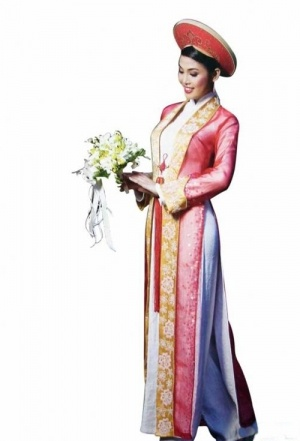 white ao dai with sheer red jacket and yellow trim