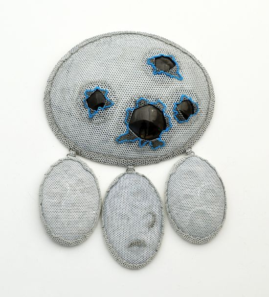 "Dana Hakim, ""My Four Guardian Angels, The Blue Series"", Brooch 02, 2012         Iron, black mirrored plastic, cotton threads, paint, lacquer. 250X180X20 mm (from Bezalel Academy)"