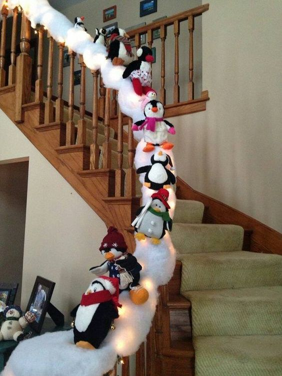 Penguin snow slide - the snow will stick to the garland then sew a thread through each penguin and tie around the banister. Easy christmas decoration for the stairs!: