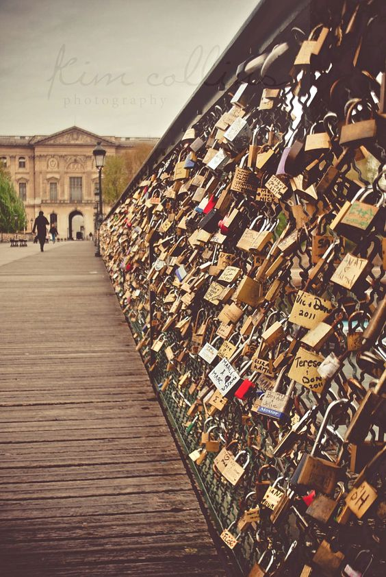 Love-Locks Bridge, Paris, France. Couples that have found the loves of their lives take a lock, lock it on the fence, and throw the key in the river. Cant wait to do this with my man someday <3:
