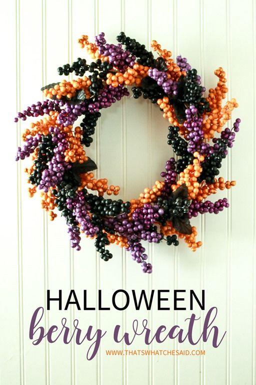 Elegant and classy Berry Halloween Wreath that is made from supplies from the Dollar Store! Inexpensive and will become your favorite holiday decor item!
