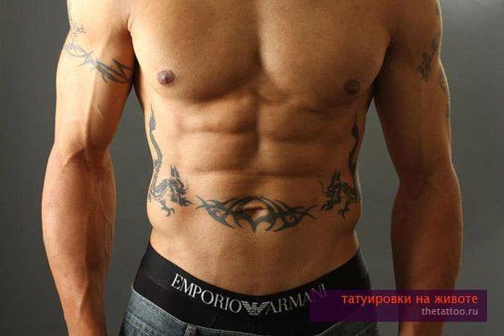 Мужская татуировка на животе