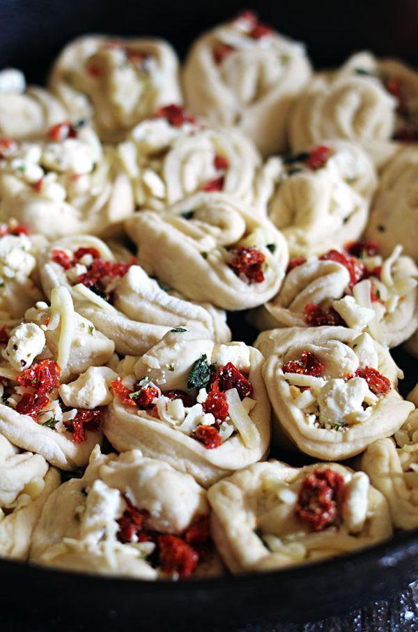 Sun-Dried Tomato & Feta Pull-Apart Garlic Knots.  Frozen bread dough makes them easy to prepare.  The toppings make them easy to devour. | hostthetoast.com