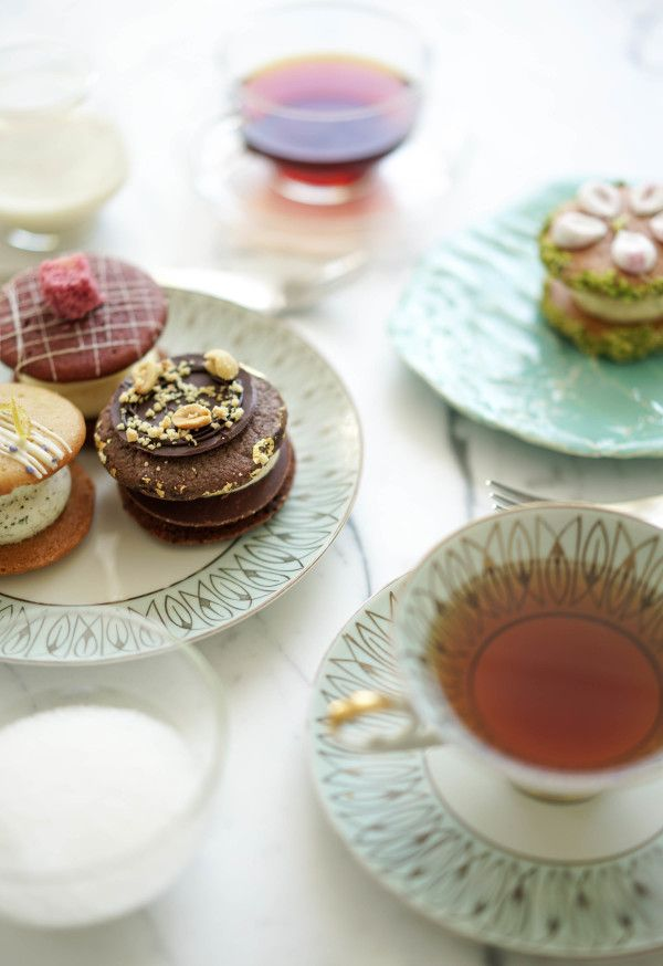 Having an afternoon tea party at home with some biskies from Cutter & Squidge, a shop in Soho!