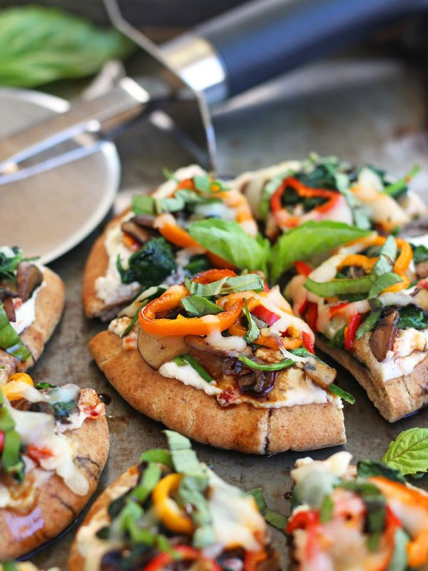 Veggie Pita Pizza Bites. Baked mini pitas topped with ricotta, sun-dried tomatoes, mushrooms, spinach and so much more.
