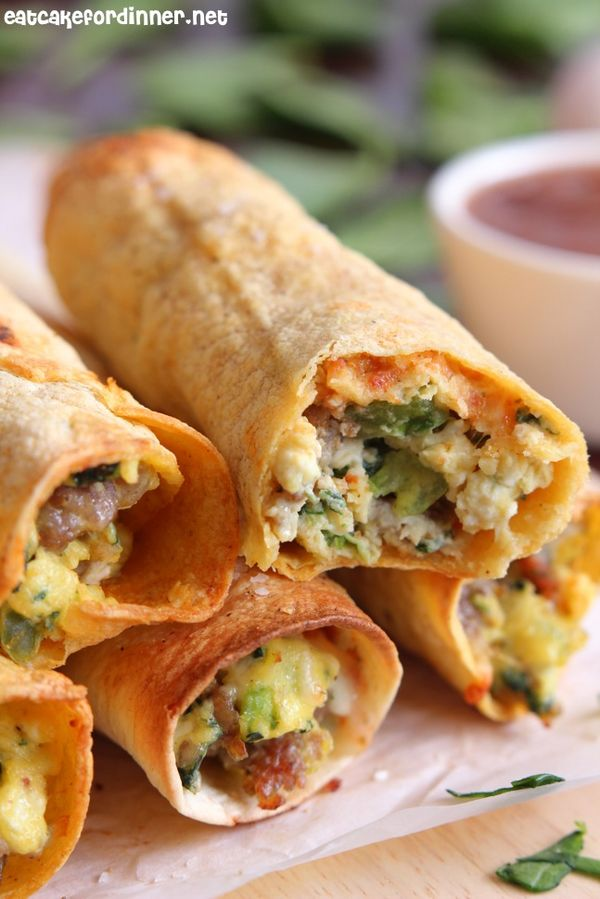 Sausage, Spinach and Egg Breakfast Taquitos... A baked taquito that is crispy on the outside and loaded with flavorful breakfast ingredients on the inside.