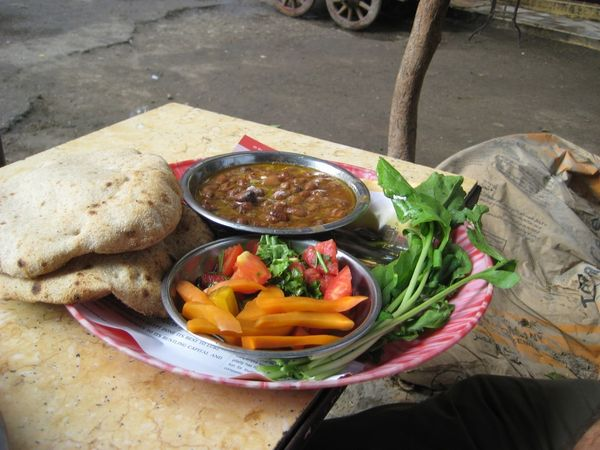 BREAKFAST IN EGYPT Fūl Medames, Egypt. Could there be anything more health-promoting than a bowl full of beans, chickpeas and lentils, served with a heaping portion of pickled veggies and arugula? The common Egyptian street food, fūl medames, is a protein-packed, fiber-filled breakfast of champions.