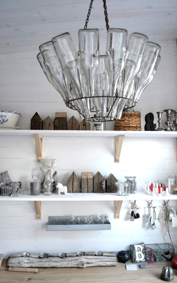 DIY Chandelier made from vintage French bottle drying rack.