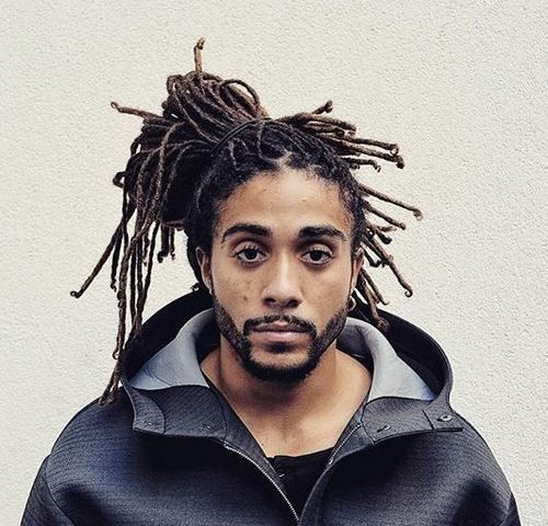 Messy ponytail locs hairstyle for men