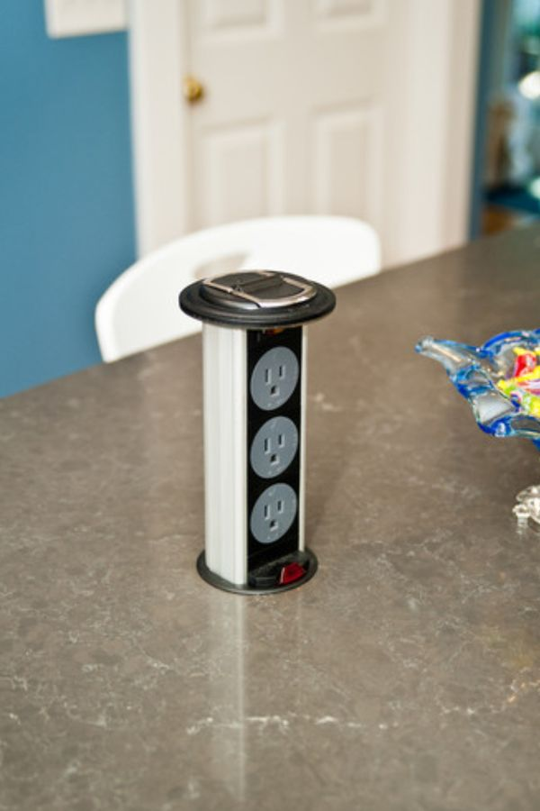 Install a pop-up outlet station in your kitchen island for extra power sources