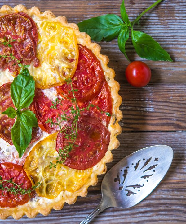 Tomato Pie with Basil and Gruyere Cheese - This pie makes a great side with grilled chicken or salmon or you can serve it with a salad for a light lunch. High quality tomatoes are a must for this pie.