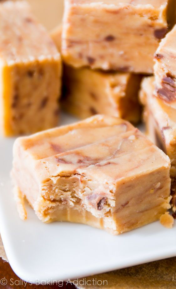 The creamiest, smoothest, peanut butteriest, BEST fudge ever! Only 4 ingredients and no candy thermometer or stove are required. @sallybakeblog
