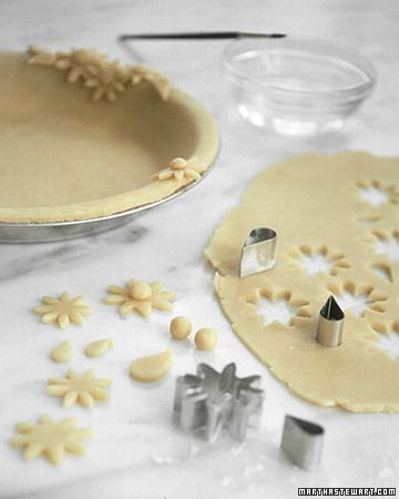 Use cookie and aspic cutters to make designs out of spare dough; then attach them with water.