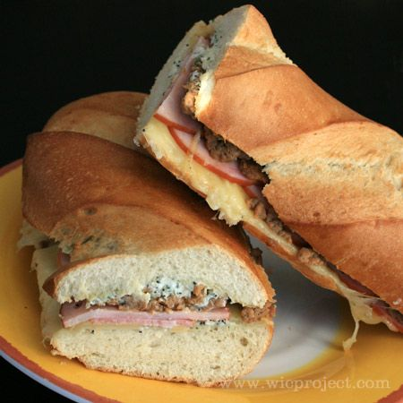 Quite possibly the best sandwich ever: Canadian Bacon and Sausage Stuffed French Bread