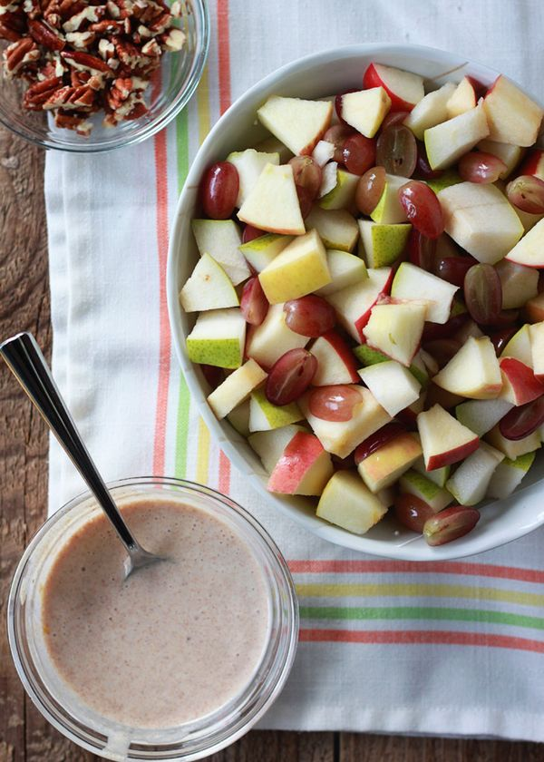 Autumn Fruit Salad with Cinnamon Greek Yogurt Dressing recipe - crisp apples, sweet pears, and red grapes tossed  with a sweet spiced yogurt and topped with pecans.