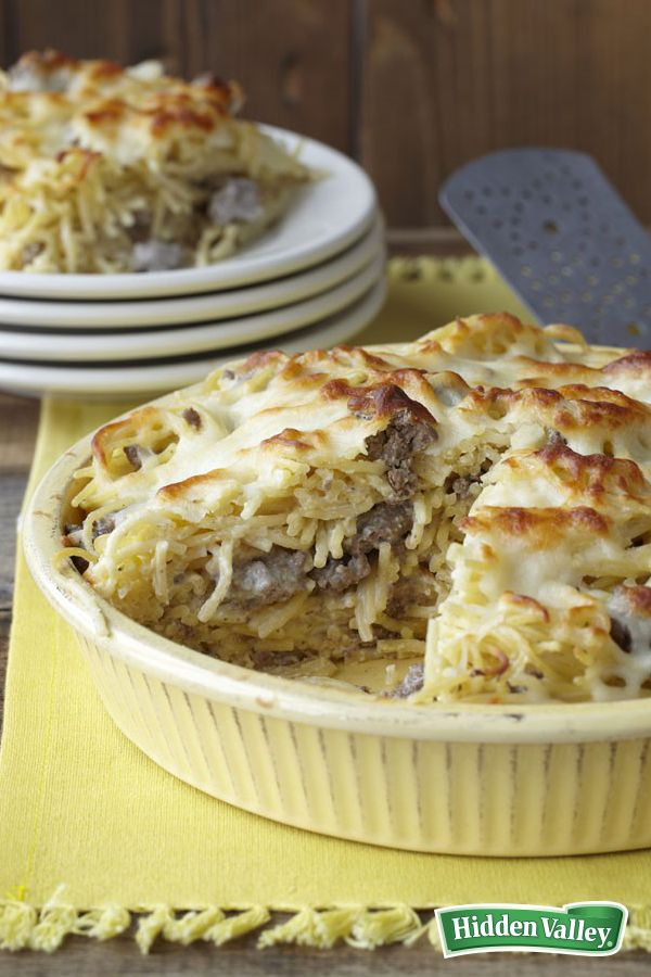 """Need a hassle-free family dinner, but everyone's tired of the usual go-to lasagna or pasta? Topped with melted mozzarella, this creamy, flavorful Spaghetti Ranch Pie recipe is your solution for picky eaters! According to one of our reviewers, """"kids love any dinner that has the word 'pie' in it."""""""