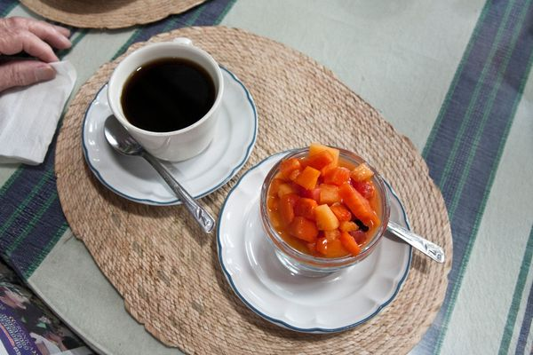 Coffee And Papaya, Brazil Papaya -- the healthful fruit that grows fresh throughout the country -- is a popular breakfast staple, delivering huge doses of vitamins A and C to diners. And coffee, for which there are myriad benefits, is a must. Its also true that Brazilian breakfasts often contain the less-than-healthy grilled pão frances, or french bread, with margarine.