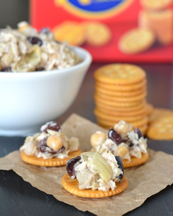 RITZ® Crackers topped with Mediterranean Tuna Salad (with artichokes, olives and chickpeas) are a delicious healthy snack! Easy, too! #PutItOnARitz #Ad www.jessfuel.com