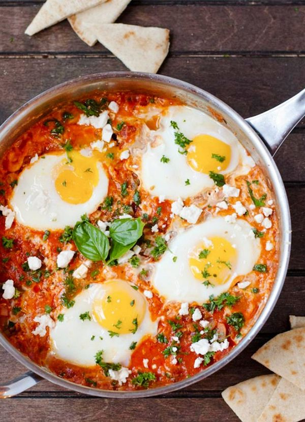 Easy Shakshuka - Gluten free and vegetarian, this spicy, tomato-based baked egg recipe makes a satisfying one-pot meal year-round.