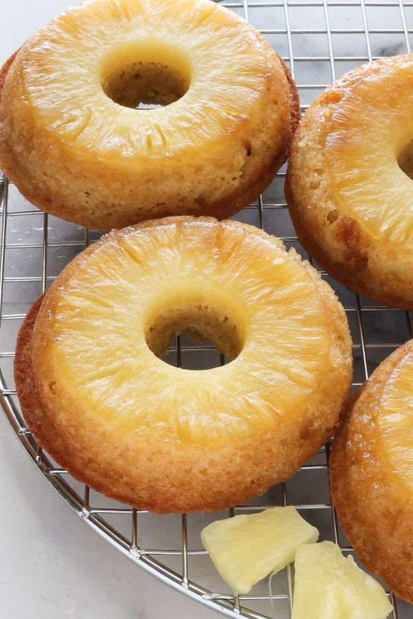 Pineapple Upside-Down Donuts - Baked donuts are topped with pineapple and brown sugar. All the taste of pineapple upside down cake in just 20 minutes!