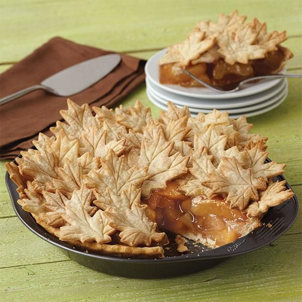 Maple leaves are gathered atop an apple pie for a signature fall dessert. Use Wilton's Leaves & Acorns Cutter Set to cut crust in various leaf sizes and bake the pie in the 9 in. deep pie pan.