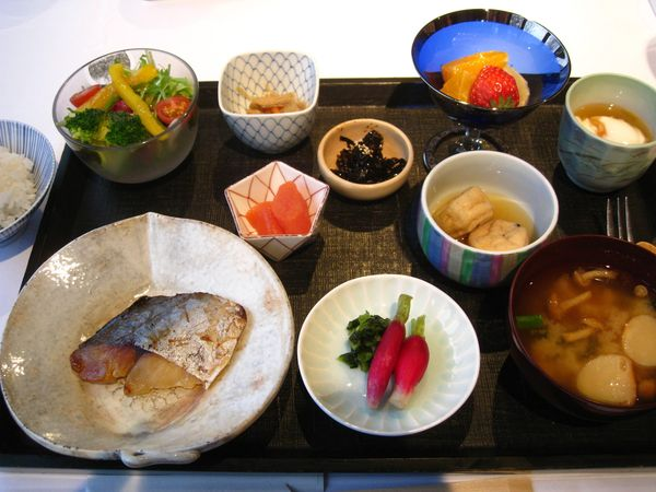 Complete breakfast in Japan: Savory, filling and low-calorie miso soup, pickled veggies, seaweed, tofu, salad and cured and raw fish comprise this common morning meal in Japan.   Thanks to omega-3 fatty acids in the fish and seaweed, fiber in the pickled and fresh veggies and the protein in the fish and tofu, this is a nutritious, low-fat, health promoting meal.