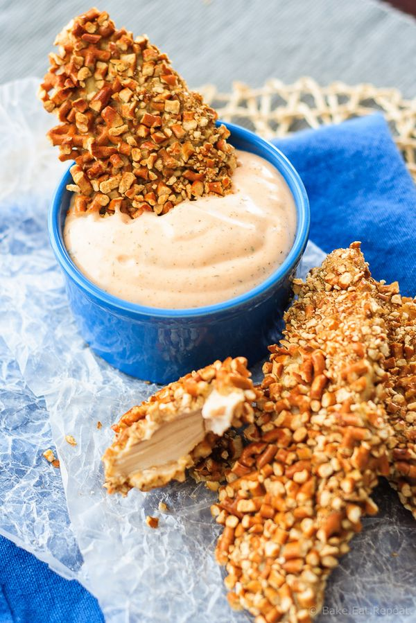 Baked Pretzel Ranch Chicken Tenders - These baked pretzel ranch chicken tenders are quick and easy to make, with a crunchy pretzel coating, and juicy ranch seasoned chicken. Plus, sriracha ranch dipping sauce!