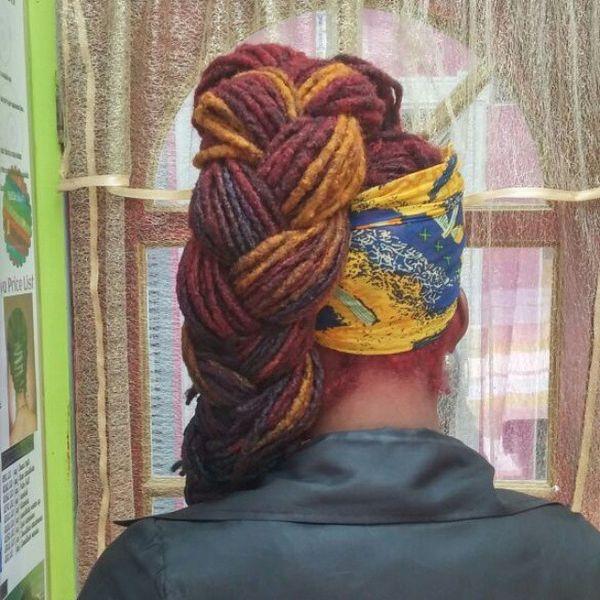 Braided ponytail locs hairstyle