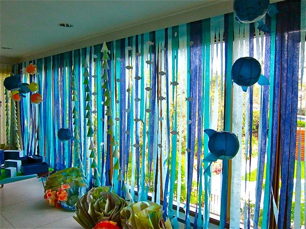 Hang crepe paper from windows, doorways or ceilings. title=