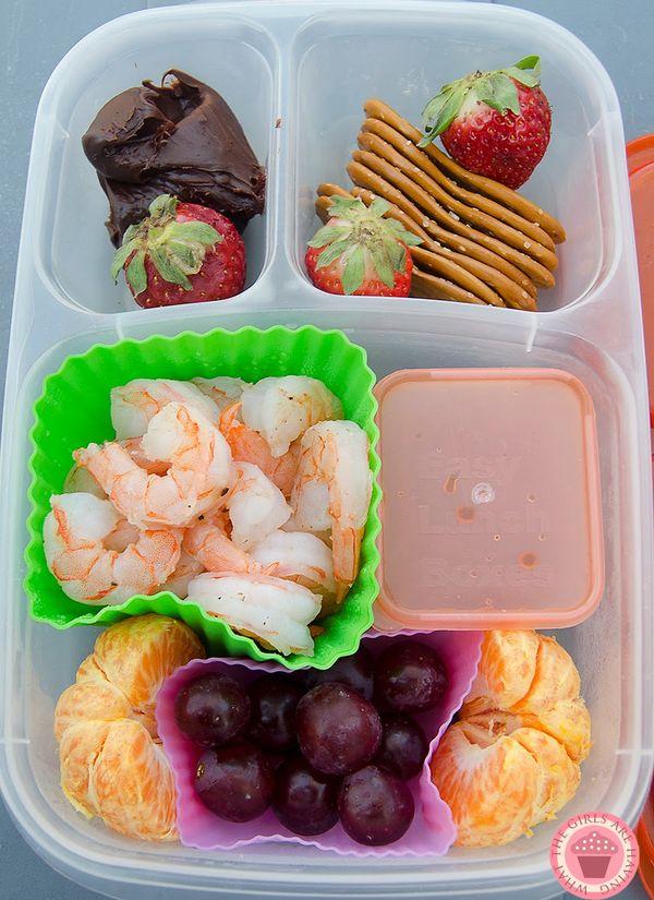 shrimp, cocktail sauce, mandarin, grapes, pretzel spoons, strawberries, nutella