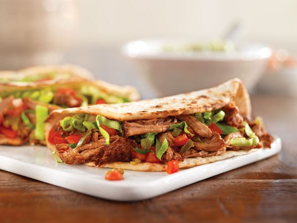 Pulled Pork Soft Tacos--Instead of assembling the tacos yourself, you can arrange the pork, lettuce, salsa, and warm tortillas on a platter and let guests make their own. If you l