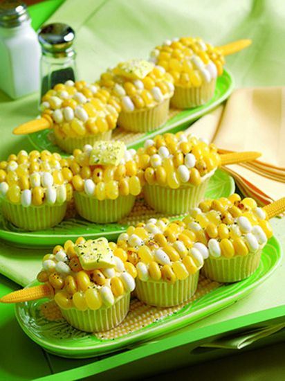14 cupcakes disguised as other foods- corn on the cob cupcakes with jelly beans as kernels!