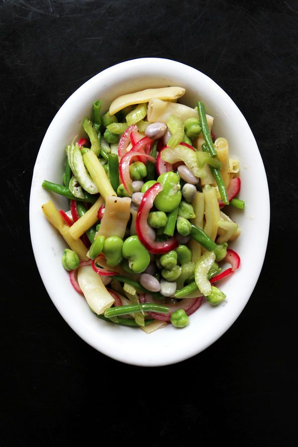 Executive editor Betsy Andrews fell in love with this bright, herb-laced bean salad at Lincoln Ristorante, the restaurant at Manhattan's Lincoln Center. A kaleidoscopic combination of fava and romano beans, garbanzos, cranberry beans, and green and yellow wax beans, it's a fresh side that's perfect for picnics and elegant dinners alike.