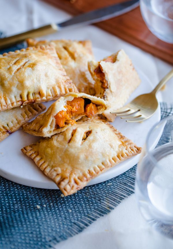 Butternut Squash and Feta Hand Pies. A delicious savory pastry!  (could maybe be a winter version of the martha stewart tomato hand pie recipe that I already have; use martha's recipe for assembly/ bake time)