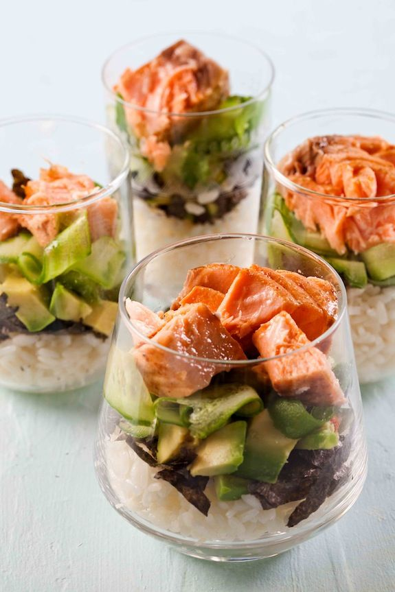 Salmon Sushi Salad ~ Start by layering cooked sushi rice. Crumble or cut Nori sheets over the rice. Add some cubed avacodo for color. Add some cucumber. Top with pieces of salmon. Sprinkle with dressing. And garlish with sesame seeds. Easy, Elegant and Delicous.