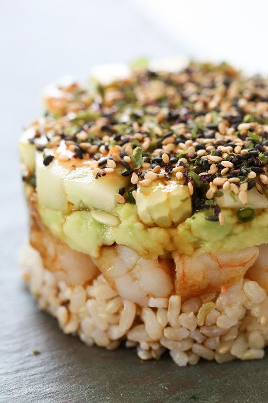 These EASY shrimp stacks will satisfy your sushi craving, and they taste SO GOOD! Layered with cucumber, avocado, shrimp and brown rice, then topped with a spicy mayo – YUM!     You don't need any fancy tools, I layered everything in a one-cup measuring cup then flipped it over.        Then topped it with spicy mayo, soy sauce and Furikake which is a Japanese condiment made with blend of sesame seeds and seaweed and spices available at most health food stores, Amazon or you can just use sesa...