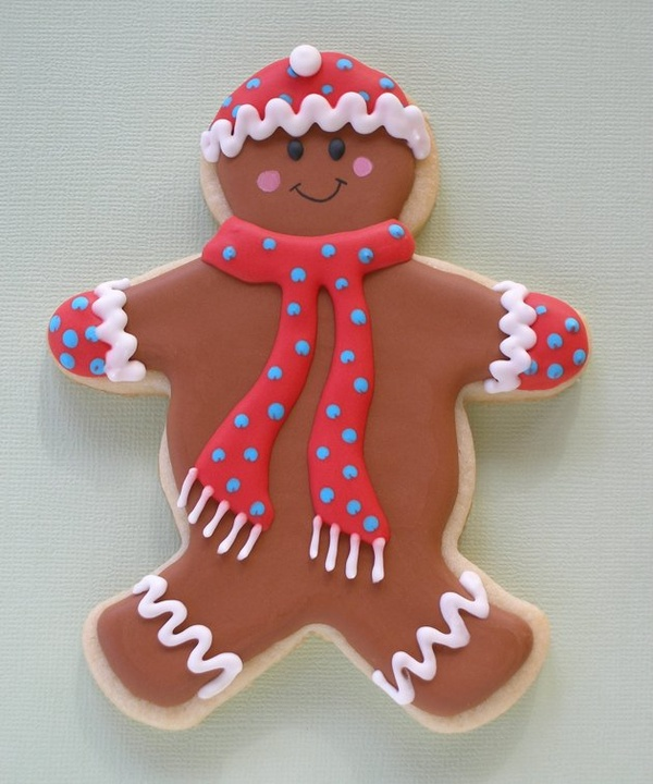 Ready for a blizzard, this gingerbread man is bundled in a matching hat, scarf and mittens.