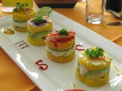 This versatile Peruvian potato dish makes a great light meal or a fine addition to a buffet spread. Causa can be layered with any number of fillings — chicken salad and tuna salad are favorites. Served cold, causa rellena is often topped with extravagant garnishes and sauces for a colorful presentation.