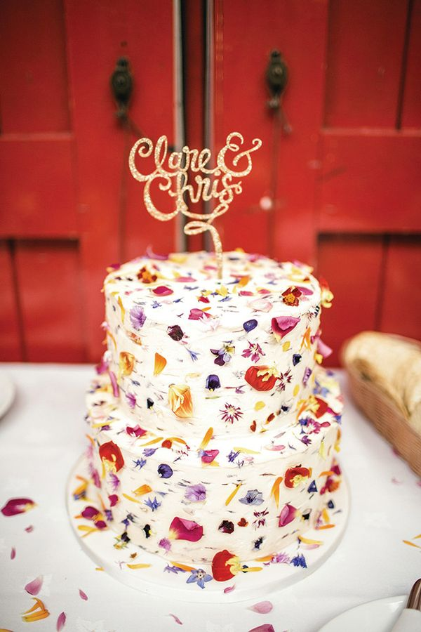 flowerfetti wedding cake | Claire and Chris' colourful and retro Islington Metalworks wedding by Kat Hill | www.onefabday.com | #Flowerfetti #WeddingCake || コンフェティみたいな花びらのウェディングケーキ