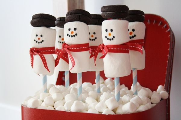 Snowman marshmallow pops at a Red and White Christmas party.   See more party ideas at CatchMyParty.com.  #christmaspartyideas
