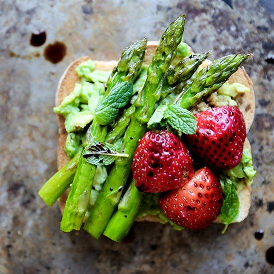 Avocado toast with roasted asparagus, strawberries, fresh mint and balsamic vinegar.