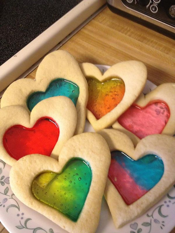 Stained Glass Sugar Cookies   Use your favorite sugar cookie recipe. Cut out the cookies with a large cookie cutter. Use a spatula to transfer the shapes to the baking sheet. Remove the centers of the cookies with a smaller cookie cutter. Place 2 Jolly Ranchers (I like using 2 different colors) in the center of each heart (or whatever shape you made) and bake according to your recipe's instructions.