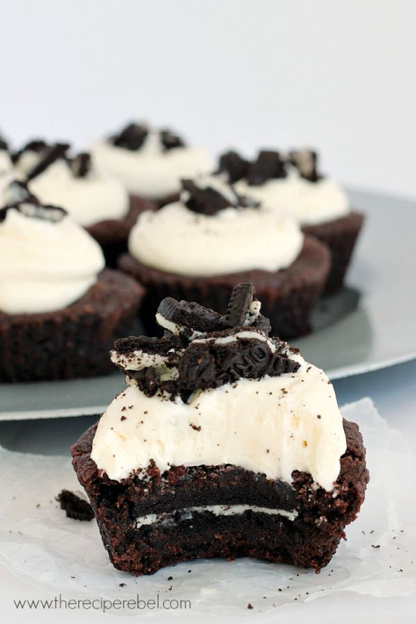 Oreo-Stuffed Double Chocolate Cookie Cups: a deep-dish double chocolate cookie stuffed with an Oreo, topped with homemade Oreo filling and crushed Oreos! www.thereciperebel.com