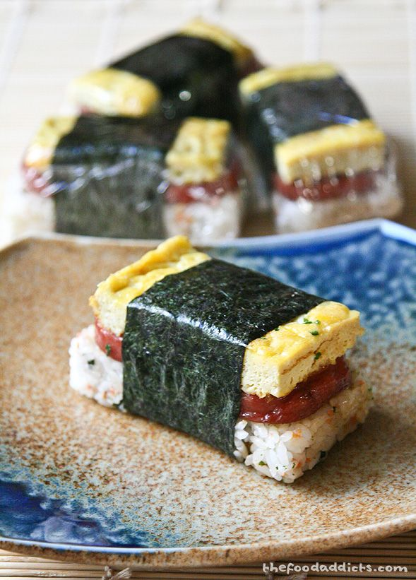 Spam Musubi - soft and sticky rice, salty teriyaki spam, a little soft and creamy omelet (non-traditional but oh so delicious), wrapped up with furikake and nori. ZOMG! So drool-worthy.