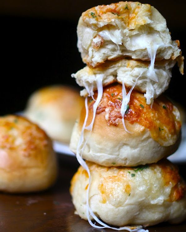 I am drooling over these Cheese stuffed garlic knots!  Just look at all of that warm, gooey cheese spilling out of there.  I want to bite into one of these right now!